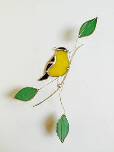 Bright yellow American Goldfinch stained glass bird on a wire branch with green leaves 3 dimentional suncatcher Stained Glass Light, Stained Glass Suncatchers, Stained Glass Flowers, Stained Glass Designs, Stained Glass Projects, Fused Glass Art, Stained Glass Patterns, Mosaic Glass, Translucent Glass