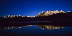 Reflection of the mountains in Chandertal lake, Lahual and Spiti, Himachal Pradesh, India.
