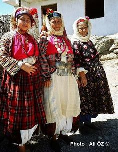 Three women in the traditional festive outfit of the village of Çomakdağ (district of Milas, Muğla province).  Ethnic Group: Yörük. The 'Yörük' are a Turkish group of people, some of whom are (semi-)nomadic, primarily inhabiting the mountains of Anatolia and partly Balkan peninsula.  Yörük maintain in general some association with nomadic life, are poorer (mostly) than average, and all of them are Sunni (unlike the Türkmen, who can be Alevi).
