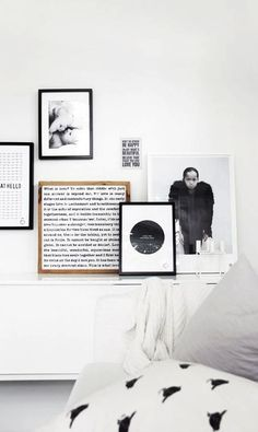 I like this idea to mix wood frame with all the black/white frames