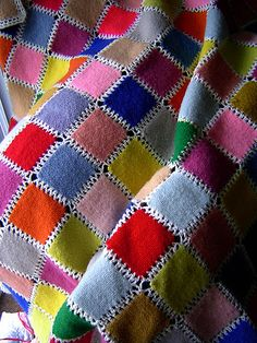Weave-It Blanket- looks like squares were made and felted, then crocheted together