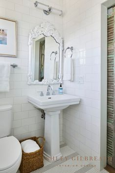 ASHLEY GILBREATH INTERIOR DESIGN: A mix of new and old, this bathroom features crisp alternating stripes of white and grey honeycomb tile and a pedestal sink, which is complimented by an antique barn door and antique mirror painted with a fresh coat of white paint. Beautiful Beach Houses, Beautiful Homes, Ashley Gilbreath, Rosemary Beach, Bunk Rooms, Three Floor, Small Dining, Maine House, Contemporary Interior