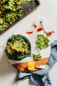 Amazingly cheesy, crispy kale chips baked in a sunflower seed/nutritional yeast coating! Healthy, simple ingredients, BIG flavor and nutrients!
