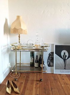 I like that lamp with the retro bar cart