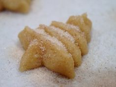 Cinnamon Sugar Spritz Cookies    2 cups cake flour  1/4 tsp. salt  1 tsp. ground cinnamon  3/4 cup (1 1/2 sticks) unsalted butter, at room temperature  1/2 cup granulated sugar  1 egg yolk  1 tsp. vanilla extract  cinnamon sugar for sprinkling
