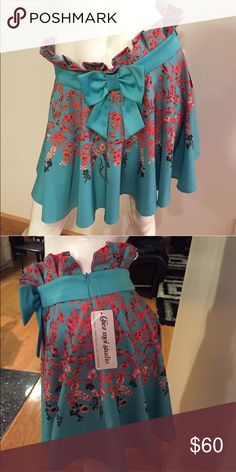 cb28d21c2f Floral skirt Beautiful floral skirt turquoise color. Size 7-8 Skirts Midi