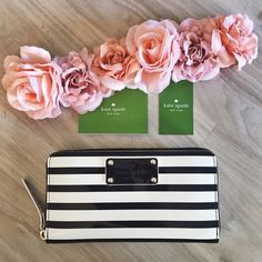 Kate Spade Wallet ♠️ Kate Spade wallet with tag. Has a little marker stain from putting it in a box when I was moving. It's still in really good condition and the inside is clean. Never been used. My price is firm. No trades. kate spade Bags Wallets