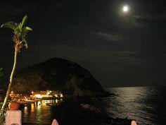 Moonlight over the water in Ischia, Italy