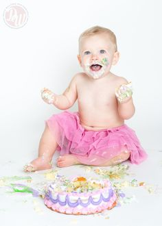 One Year Old Baby Girl Smash Cake EXTRAVAGANZA!  Pink tutu wearing little girl enjoys her very own Birthday Cake during portrait photography session in Ponte Vedra Beach Florida.  #smashcake #babyphotography #birthday #cake #oneyearold #babygirl #tutu #babyphotographer #photography #PonteVedra