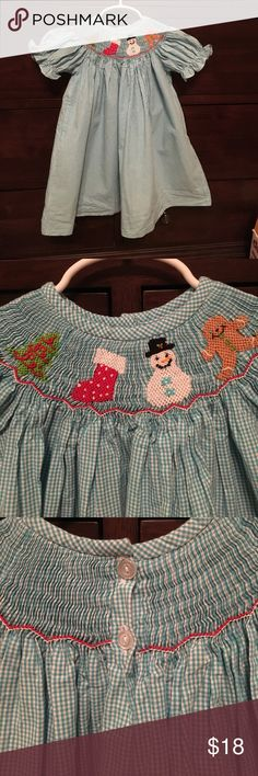 EUC smocked Christmas bishop dress size 18 mo Santa/Christmas tree/snowman/gingerbread smocked detail. Beautiful light blue gingham patterned fabric (does not display well in these photos- nice bright blue). Two-button closure in back. Worn 1-2 times, washed and line dried. No flaws Smockadot Dresses