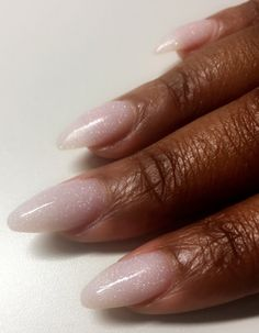 Nude blush acrylic. Not polish. In between almond and stiletto nail shape