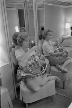 Debbie Reynolds playing the French horn