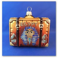 Egypt suitcase. Pharaoh painted on one side of the suitcase. Mouth blown glass Christmas ornament. Found on Vintage Treasures Ornaments