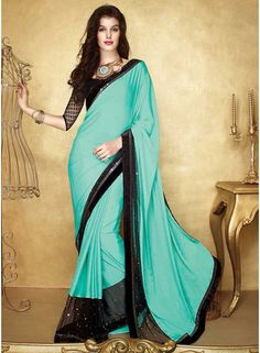 Dashing Turquoise And Black Patch Border Work Party Wear Saree. Pair With Designer Black Blouse.  http://www.angelnx.com/Sarees/Party-Wear-Sarees/dashing-turquoise-and-black-patch-border-work-party-wear-saree_10511