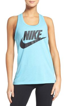 essential logo tank by Nike. A loose silhouette and wide racerback perfect the freeing fit of this running singlet featuring a signature Swoosh at...