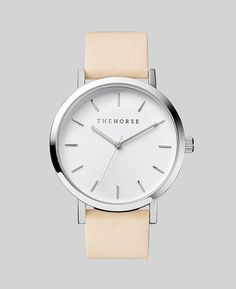 """""""The Original"""" time teller by The Horse with a polished stainless steel case, white face with minimalist markers, and a vegetable tanned leather band."""