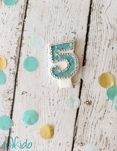 Customized Embellished Number Birthday Candle.  Take a 99 cent number candle and a little glitter and glue and make something spectacular for the birthday cake!