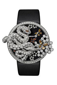 Relógio e aplicação de pregadeira da coleção Les Indomptables em ouro branco, diamantes, granadas e bracelete em pele, Cartier