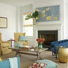 brown leather couch with yellow and teal accents | ... accent table, gold drum table, blue sofa, blue wingback sofa, yellow