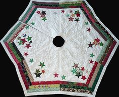 Scrappy Christmas Tree skirt, the stars are outline quilted & there are star outlines quilting the white portion, as well. Sentiments of the season are embroidered around the calico border. Christmas Skirt, Christmas Sewing, Christmas Fun, Christmas Stockings, Christmas Items, Christmas Projects, Christmas Crafts, Christmas Decorations, Xmas Tree Skirts