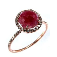 Feel like royalty while donning this rose gold ring set with a stunning ruby and a halo of sparkling diamonds.