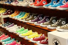Converse. I want them!!!! so cool man thats a lot of shoes lol