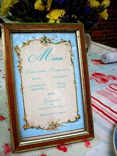 Menu in frame - If they were small frames, there could be a small one at each place.  Bigger frames, one at each end of the table...