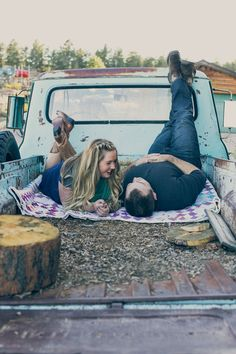 Cute fall engagement photo in the back of a pick-up truck at The Barn at Casey's. #weddingphotography