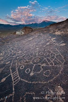 Sky Rock petroglyphs near Bishop, California.  Hidden atop an enormous boulder in the Volcanic Tablelands lies Sky Rock, a set of petroglyphs that face the sky.  These superb examples of native American petroglyph artwork are thought to be Paiute in origin, but little is known about them. Bishop, California, USA, natural history stock photograph, photo id 26979