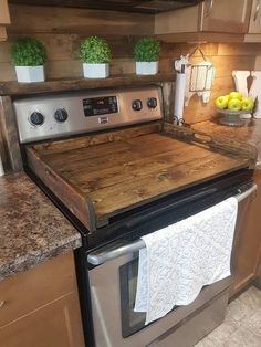 Wooden stove cover with handles to use as a tray.