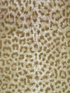 Picture does not do it justice. This is an awesome not-skanky leopard print (cheetah, really) for your home. Good for upholstering x-stools or a bench or something. Really chic in person. See more about it here:     http://decorno.blogspot.com/2012/03/decorno-is-your-personal-fabric-shopper.html