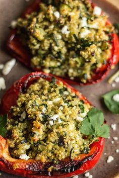 Stuffed peppers with quinoa, courgette and feta. Replace onion with green onion tops