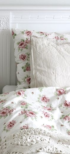 I like this rose pattern, I'd cover the rest with lace crochet blanket/some kind of grey throw blanket to match the rest of the room.