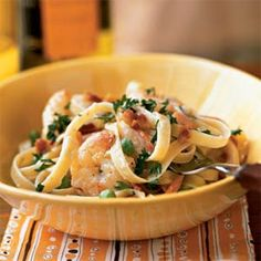 A dish of shrimp sautéed in bacon drippings and tossed with fettuccine sounds like a no-no for the calorie conscious. But at under 400 calories a serving, indulge! Cook the fettuccine al dente so the strands remain intact and maintain their slightly firm texture.