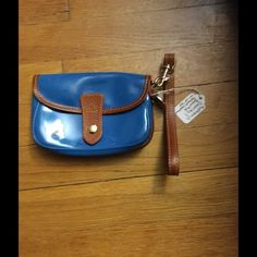 Authentic Dooney and Bourke wristlet This beautiful patent leather wristlet is great for a night on the town or for a quick errand. The beautiful blue gives that pop of color a girl needs. Dooney & Bourke Bags Clutches & Wristlets