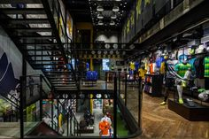 Celebrating the sporting heavyweight's heritage with Brasilian football, the three-story outpost is outfitted in the Brazilian national team's colors while Carioca graffiti artist Mateu Velassco's compelling illustrations take on the distressed brick walls.