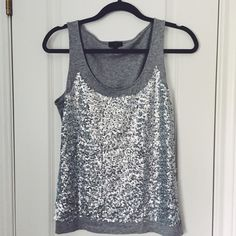 Glam Talbots Sequin Tank Festive Talbots Sequin Tank, women's petite M, soft grey cotton tank with mesh panel on the front and the sequins sewn on. Great used condition -rarely worn. The sequins are a slight matte that makes it more beautiful! Offers welcome ↘️ Talbots Tops Tank Tops