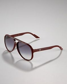 Rounded Plastic Sunglasses by Gucci at Bergdorf Goodman.