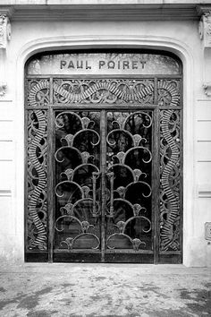 Poiret commissioned Edgar Brandt, the premier Art Deco ironworker, to design the grillwork doors and interior staircase for his atelier at 1 Champs-Elysées, Round Point, Paris, 1925