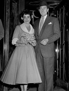 Wedding # 2: Michael Wilding, 1952-1957  After her divorce from Nicky Hilton, the silver screen starlet wed Michael Wilding, an English actor, in London. Her outfit choice for the simple civil ceremony was decidedly demure compared to the over-the-top fashion choices Liz would be known for.