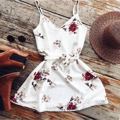 Material: Polyester Style: Casual Silhouette: A-Line Pattern Type: Print Sleeve Length(cm): Sleeveless Dresses Length: Above Knee, Mini Sleeve Style: Spaghetti Strap Waistline: Natural