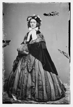 """Miss Chesney,  c. Late 1850's-1860's. Looks like a """"Marie Stuart"""" bonnet with the front-dipped brim."""