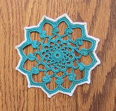 crochet coaster from a single motif out of a vintage table cloth... Want the pattern!
