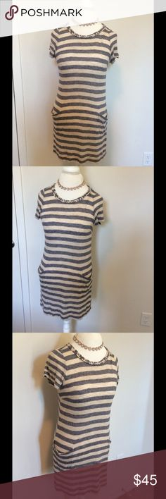 "Super cute Marc Jacobs dress with pockets! Super cute Marc by Marc Jacobs knotted necklace dress with deep pockets! Light fading/discoloration but looks like part of he dress.  Colors of this dress are gray and white/cream stripes. Has a tiny red pen mark on is the ""M"" inside the tag, can't really see. The right pocket needs a quick stitch. See photos. Gently love, looks great with leggings. Got tons of compliments wearing this. Measurements approx length from top of shoulder to bottom of…"