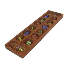 Solid natural wood.Size: Length - 17 Inches; Width - 4.7 inchesGlass marble pieces in a pouch.Handcrafted by artisans of India.Handcrafted in India.This item can be shipped to US and Europe%...