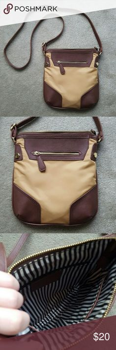 NEW! Charming Charlie Crossbody BRAND NEW! NEVER BEEN USED! Charming Charlie two tone Brown crossbody / satchel bag! Perfect size for going out! One zipper on the front - One zipper inside - 2 pocket compartments inside - Adjustable straps. No trades. Charming Charlie Bags Crossbody Bags