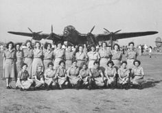 1944: The WAAAFs based at Rockhampton, in front of a Lancaster