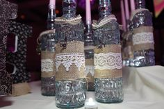 My sweet 16 candle lighting ceremony, all made by us--purchased letters that we glued fabric, lace, string, pearls, crystals, and ribbon; purchased bottles with burlap, lace pearls and owl pendants