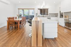 This timber servery acts as a bar, creating a seamless transition between the kitchen and dining room. Kitchen Dining, Dining Room, Seamless Transition, Custom Cabinets, Cabinet Design, Custom Design, New Homes, Interiors, Bar