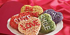 """Make these bright, colorful heart shapes for your little Valentines. Use a little frosting to """"sign"""" them with love."""